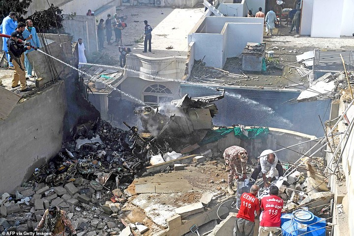 Pakistan plane crash: Two people pulled out alive from wreck of Airbus A320 that crashed in Karachi after