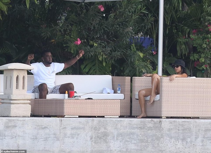 P. Diddy spotted with another mystery woman at his Miami Beach mansion few days after he was pictured kissing model Tina Louise (Photos)