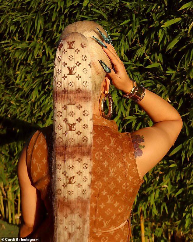 Cardi B's blonde Louis Vuitton ponytail
