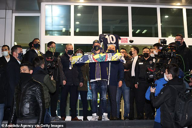 Mesut Ozil arrives in Turkey with his family ahead of his unveiling at Fenerbahce as his seven-and-a-half-year spell at Arsenal finally ends (photos)