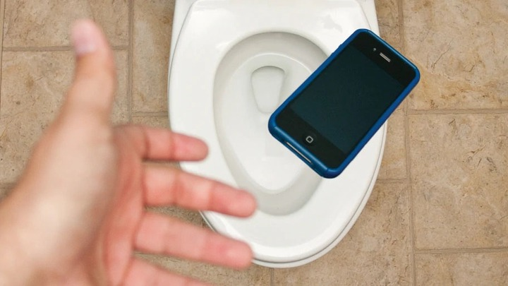 Pressing Phone inside the Toilet