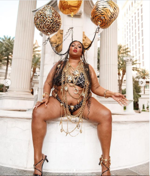 Lizzo showcases her famous curves in a tiger-print bikini to celebrate her 33rd birthday (photos)