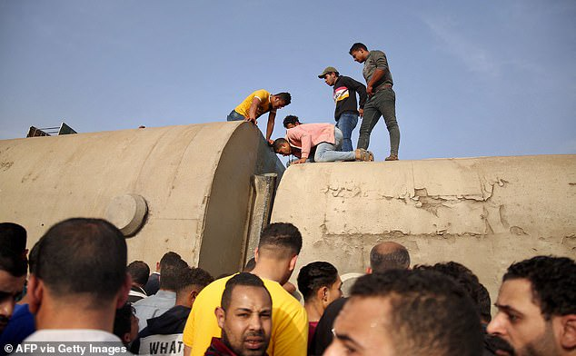 At least 11 people are killed and 100 injured as four passenger train carriages derail in Egypt?(photos)