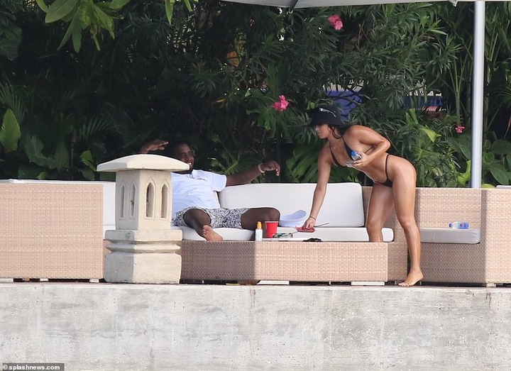 Hip-pop mogul, Diddy spotted with mystery woman at his Miami Beach mansion days after he was pictured kissing model Tina Louise (Photos)