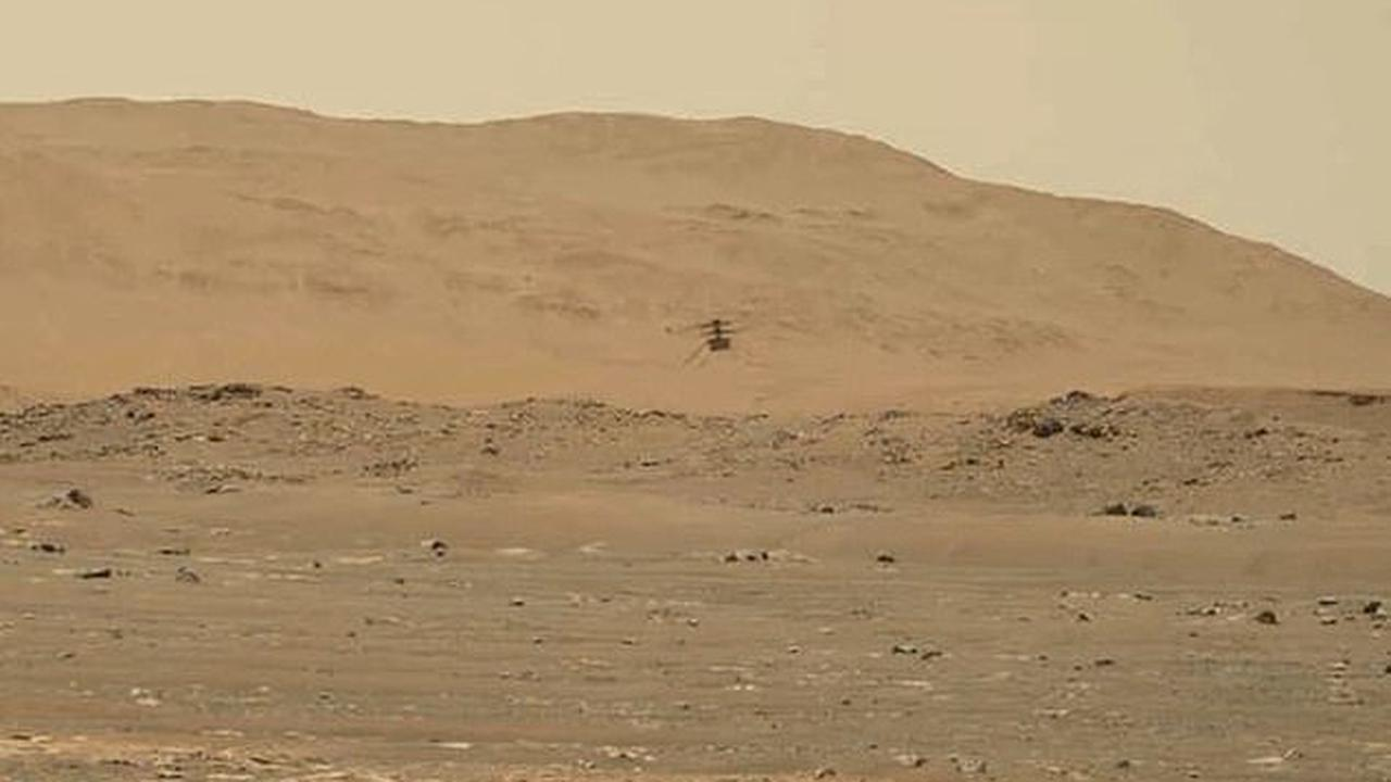 Listen to Ingenuity fly on Mars! NASA releases 'surprise' audio of the hum of the helicopter's rotors captured by Perseverance rover as it soared 262-feet above the surface during its fourth flight