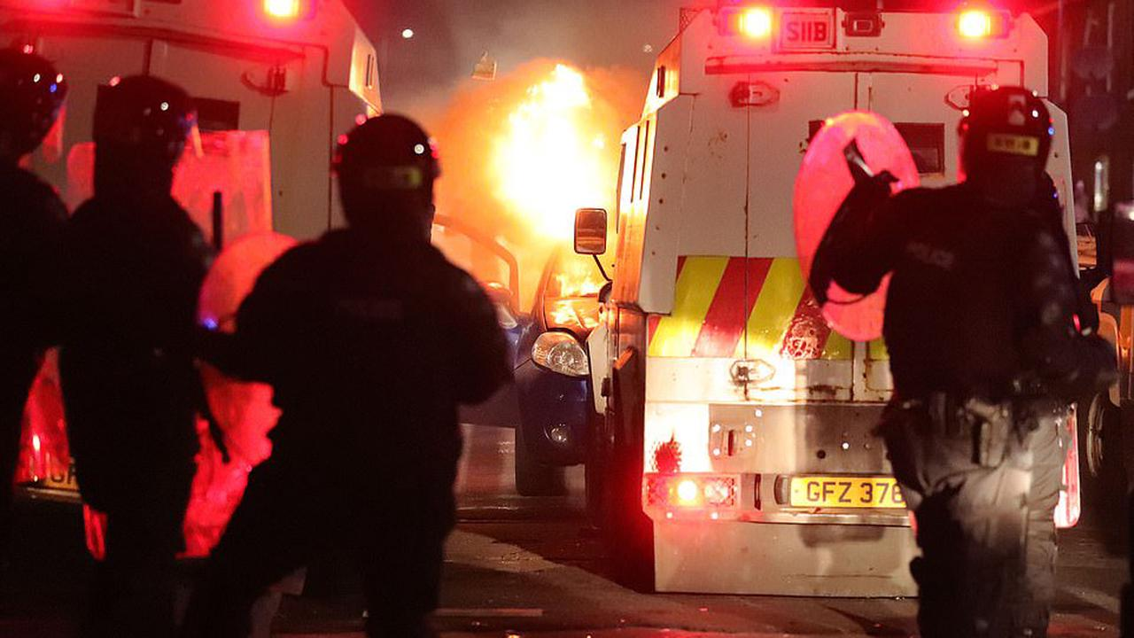 Two men appear in court over Belfast riots as police are pelted with stones and missiles on eighth night of violence