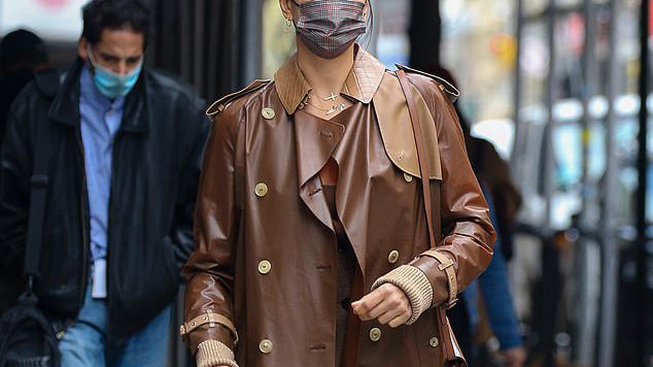 Irina Shayk oozes glamour in bronze leather coat as she rocks sleeks shades during solo NYC outing