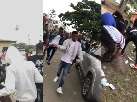 Suspected Yahoo Boys Spray Naira Notes After Final Exam As Other Student Struggle To Pick (Video)