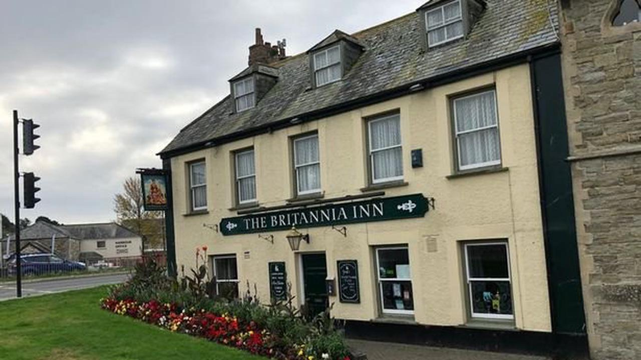 Videos show Britons getting beers in the freezing cold as England reopens pubs following a long COVID-19 lockdown