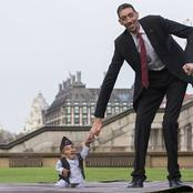 Moment the shortest man met the tallest Man in the world