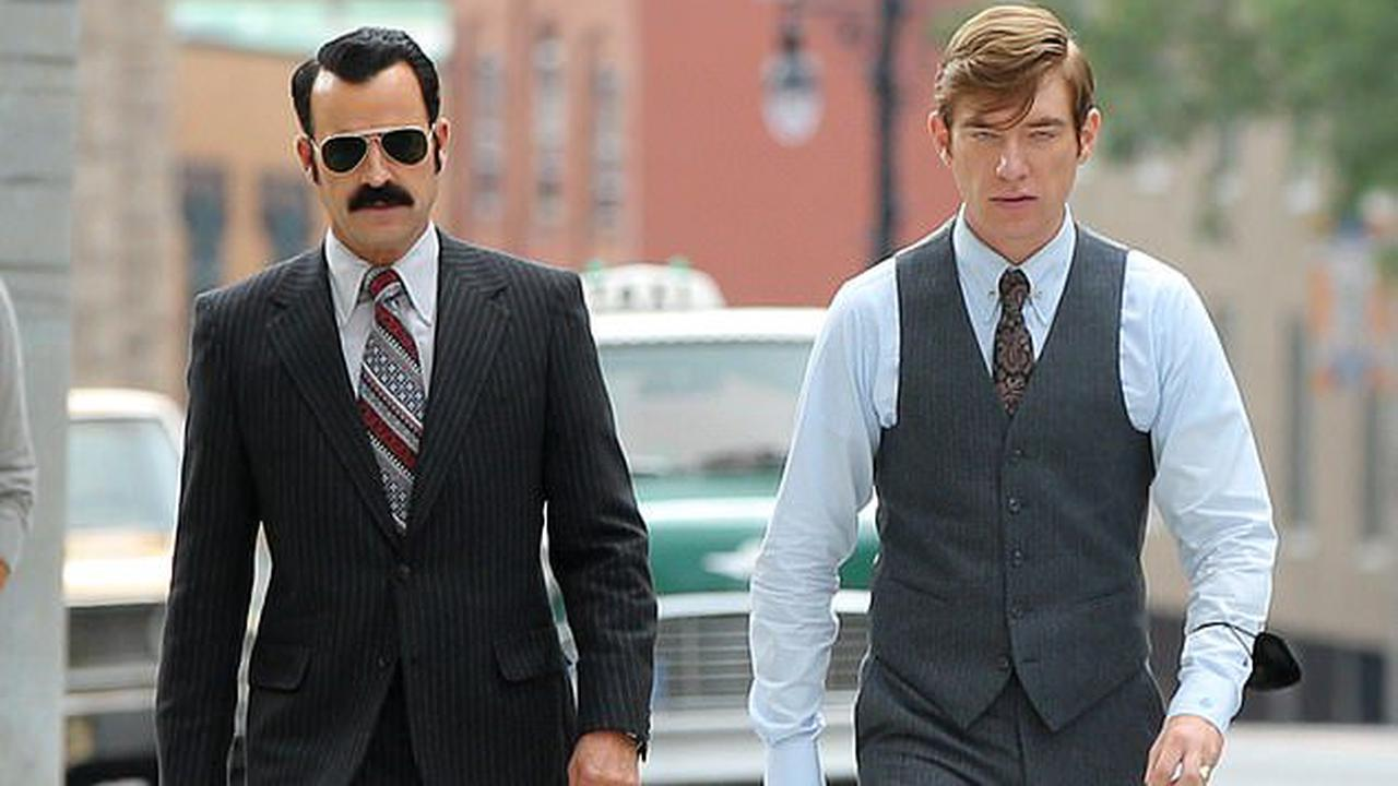 Justin Theroux rocks a thick mustache as G. Gordon Liddy on set with Domhnall Gleeson while filming Watergate scandal miniseries The White House Plumbers