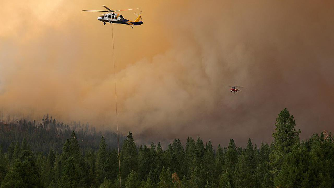 Thousands are forced to flee Dixie Fire and firefighter attempt to hold it back as it races toward Paradise where 85 people were killed in 2018