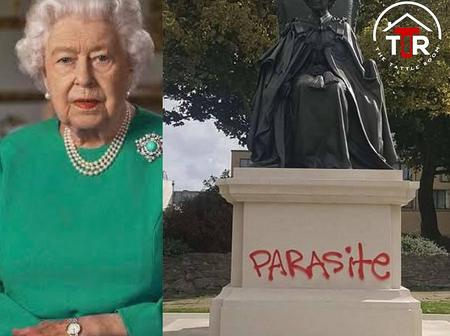"""""""Parasite"""" painted on a statue of Queen Elizabeth in England"""