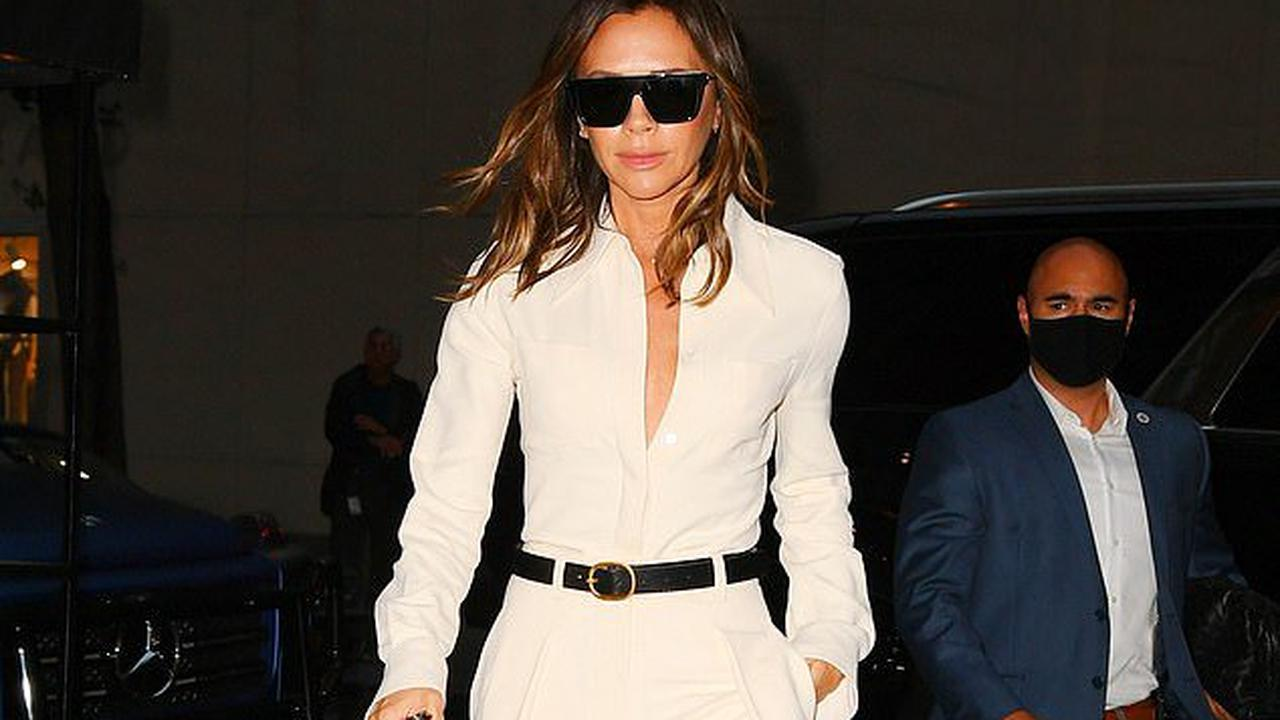 Victoria Beckham stuns in a stylish white wide-legged jumpsuit and platform heels as she returns to NYC hotel after Tonight Show appearance