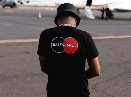 Wizkid rocks an all black 'Balenciaga' outfit as he goes out on a private jet trip with his crew