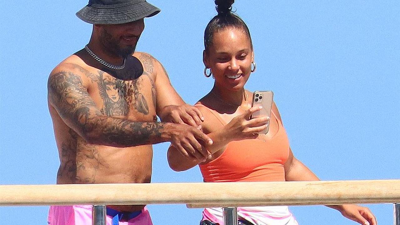 PICTURE EXCLUSIVE: Alicia Keys slips her curves into a colorful wetsuit as she and hunky husband Swizz Beatz let loose on a superyacht in the South of France