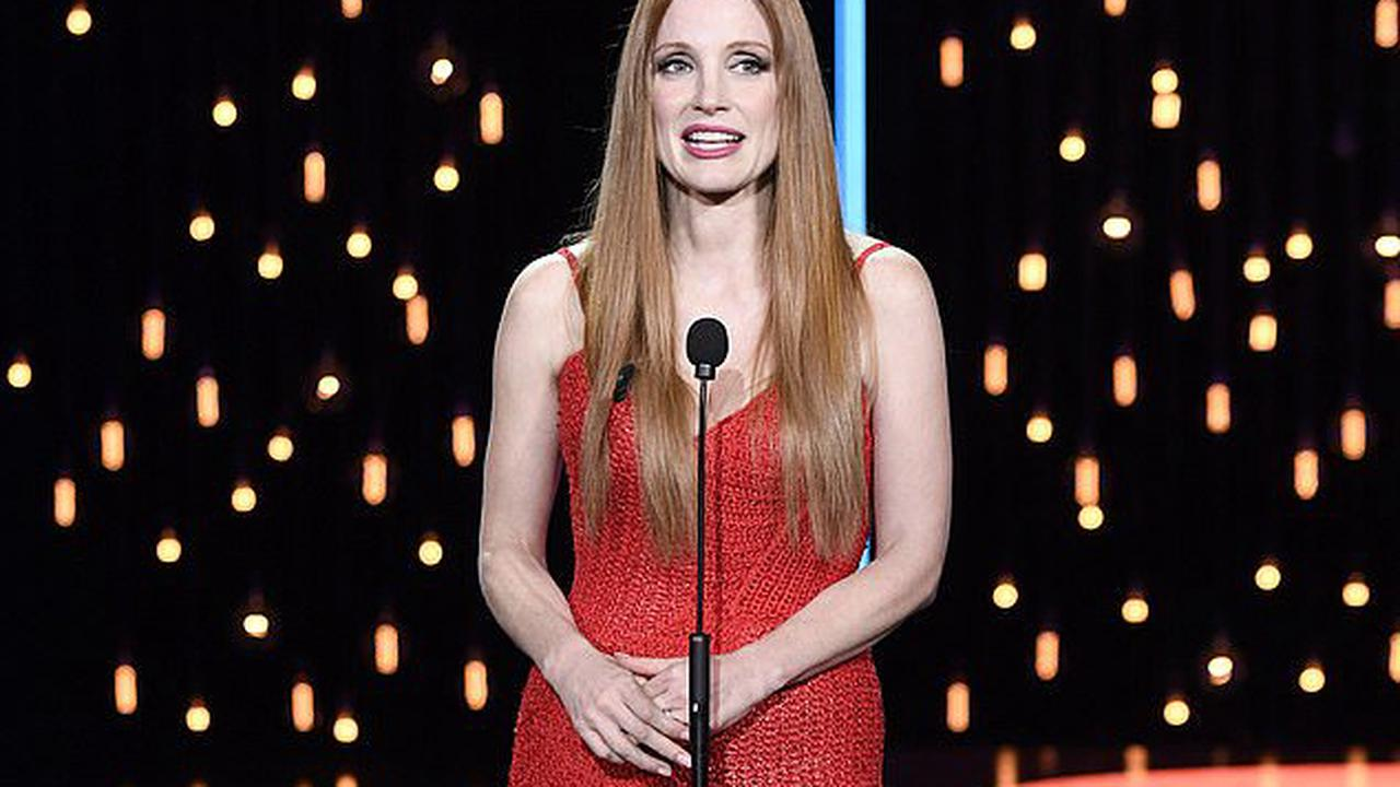 Jessica Chastain looks glamorous in a red tassel gown as she accepts award for In The Eyes of Tammy Faye at the San Sebastian Film Festival in Spain