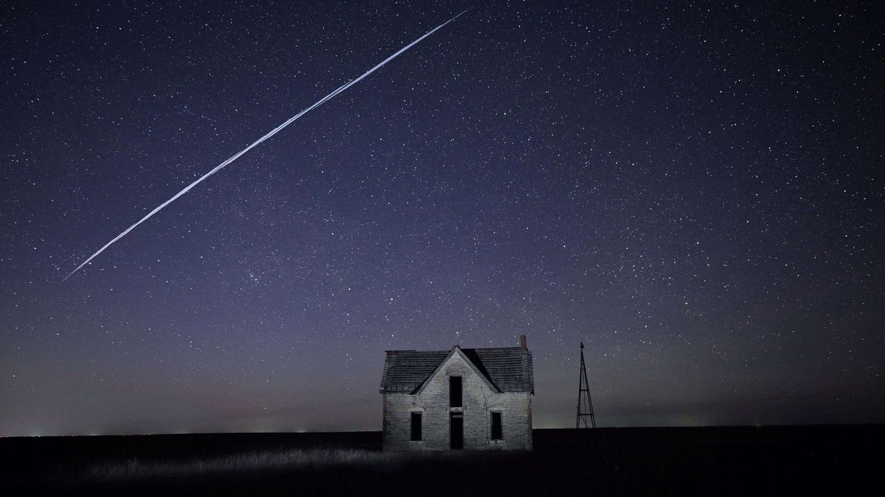 Starlink satellites create a line of bright lights in night sky, causing a stir