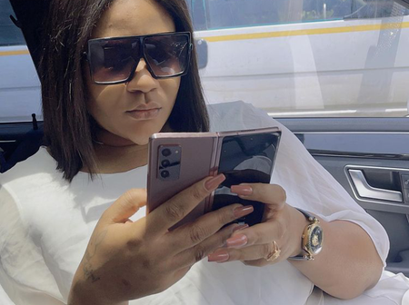 Popular Actress Stuns In White Outfit As She Shows Off Her Mercedes Benz