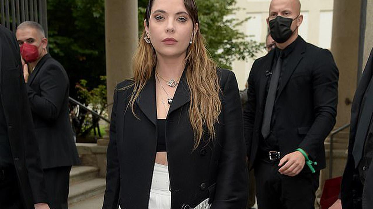 Ashley Benson displays her fashion credentials in a fringed jacket as she attends Salvatore Ferragamo show at Milan Fashion Week