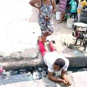 See What A Man Did To Her Pregnant Wife After She Could Not Cross Gutter Because Of Labour Pains