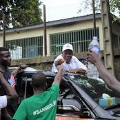 Voici l'image de la campagne: Ouattara Dramane qui salut avec respect les partisans de Jacques Ehouo