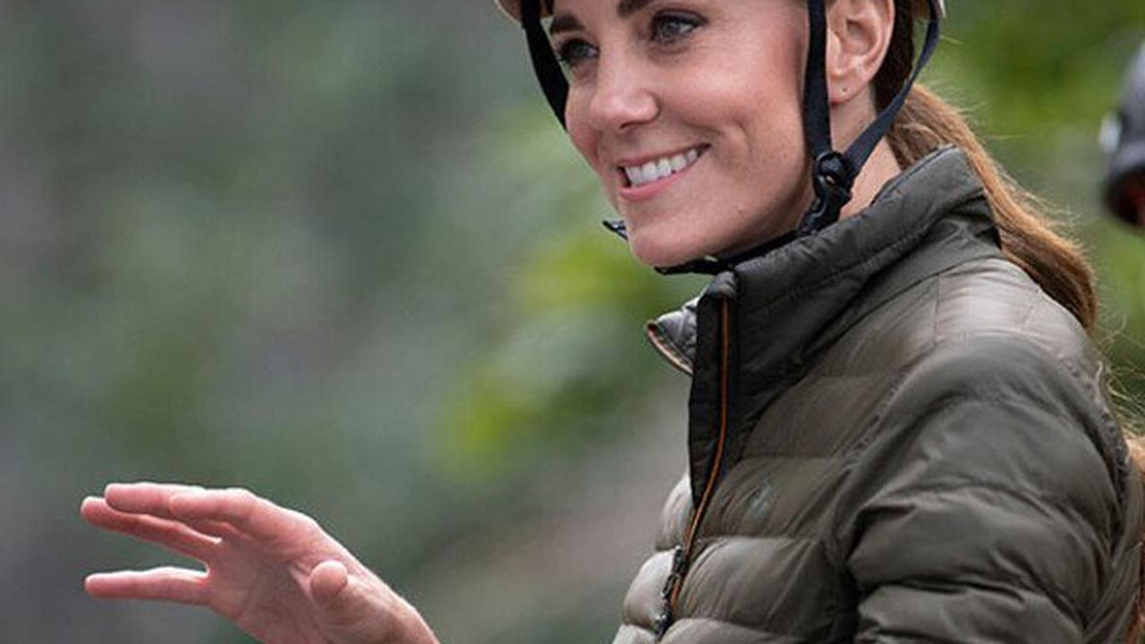 Sporty Kate Middleton in her element abseiling and mountain biking - best photos