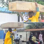 Lagos based Pastor carries Coffin on the street, says God is not happy with Buhari Government.