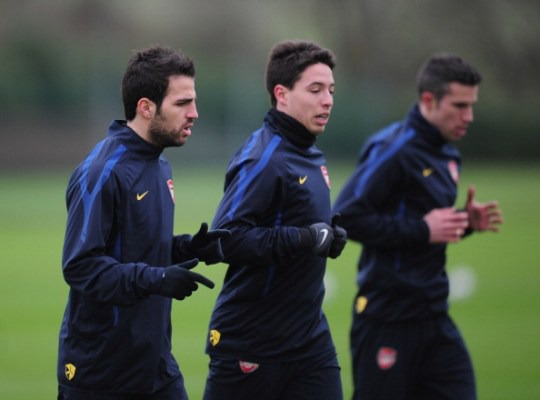 ST ALBANS, ENGLAND - FEBRUARY 15:  Cesc Fabregas, Samir Nasri and Robin Van Persie of Arsenal warm-up during training at London Colney on February 15, 2011 in St Albans, England.  (Photo by Shaun Botterill/Getty Images)