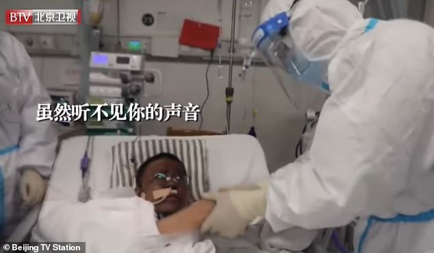 Dr Hu was not able to speak at the time, but he shook hands with his doctor to thank him
