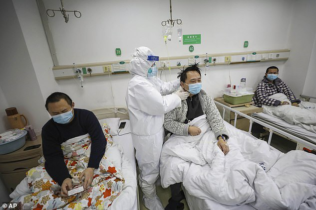 Dr Yi, a cardiologist, and Dr Hu, a urologist, work for the Wuhan Central Hospital. The file photo show a doctor checking the condition of a COVID-19 patients in Wuhan on February 13