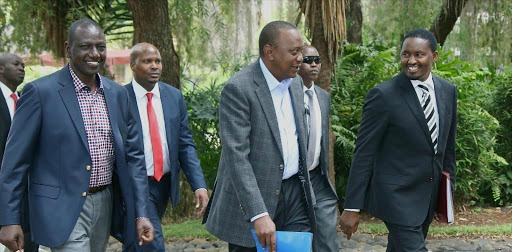 President Uhuru Kenyatta, DP William Ruto and Devolution CS Mwangi Kiunjuri at the venue for the Fifth National and County Government Coordinating Summit at State Lodge, Sagana. /FILE