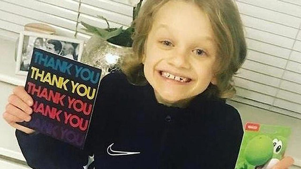 Mourners line streets and Liverpool don special shirts to pay tribute to fund-raising hero, nine, killed by lightning at football training