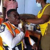 Check Out The Hilarious Facial Expression Of This Policeman As He Took His Shot Of The Vaccine