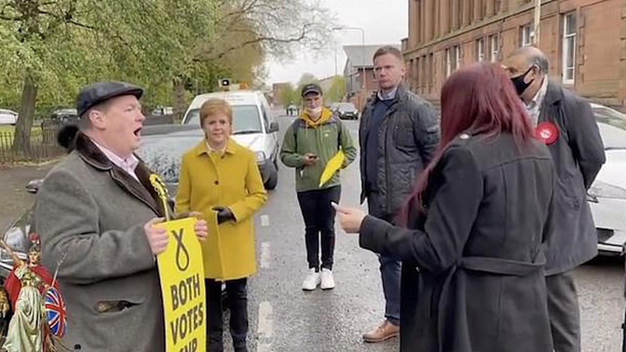 'You are a racist and a fascist': Nicola Sturgeon in extraordinary clash with ex-Britain First deputy Jayda Fransen after First Minister's seat rival confronted her outside a polling station