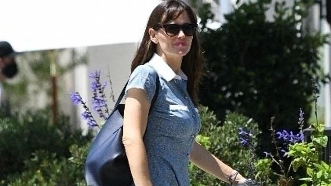 Jennifer Garner mixes fashion with function as she steps out wearing a blue floral dress and trainers amid Bennifer reunion