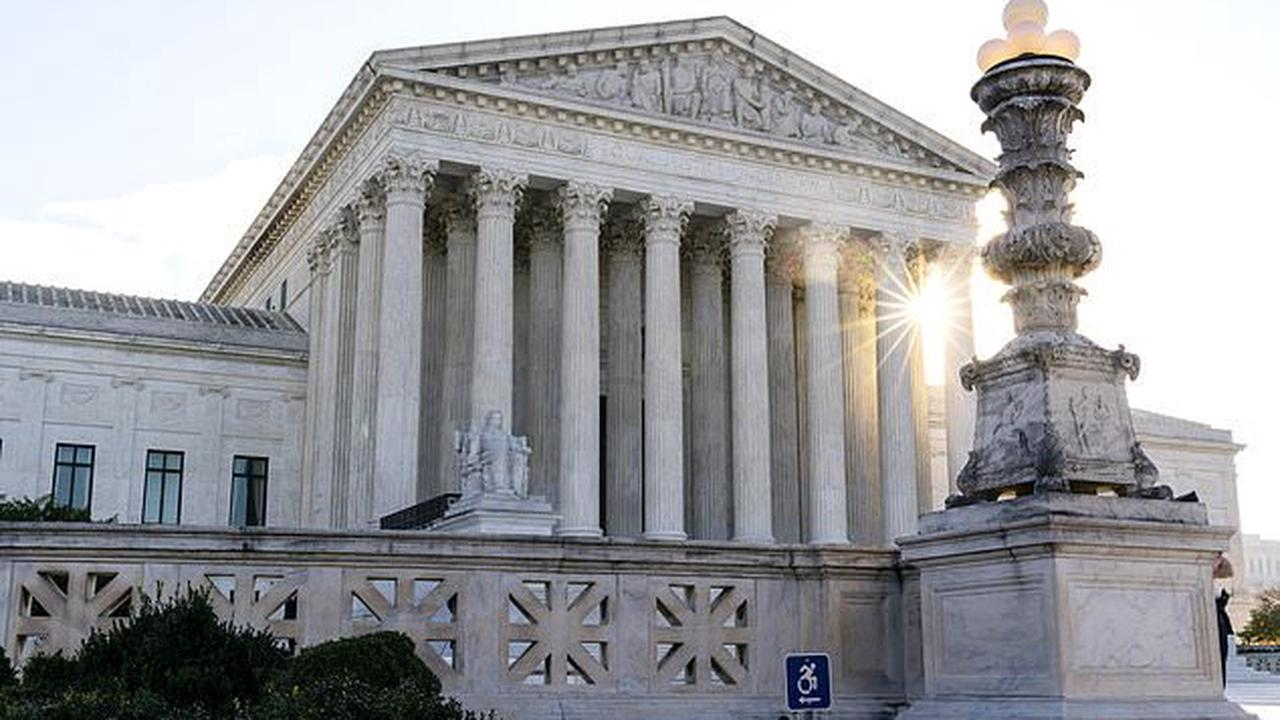 Supreme Court overturns conviction of Georgia police officer who used a government computer to see if a stripper was an undercover cop in opinion to stop turning 'every day activities' into a federal crime