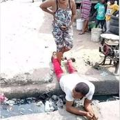 See The Moment A Man Laid Across A Gutter To Allow His Pregnant Wife Cross Over