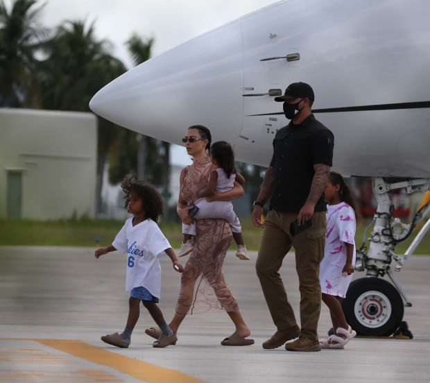 Kim Kardashian and Kanye West land in Miami after ?make or break? trip in the Dominican Republic (photos)