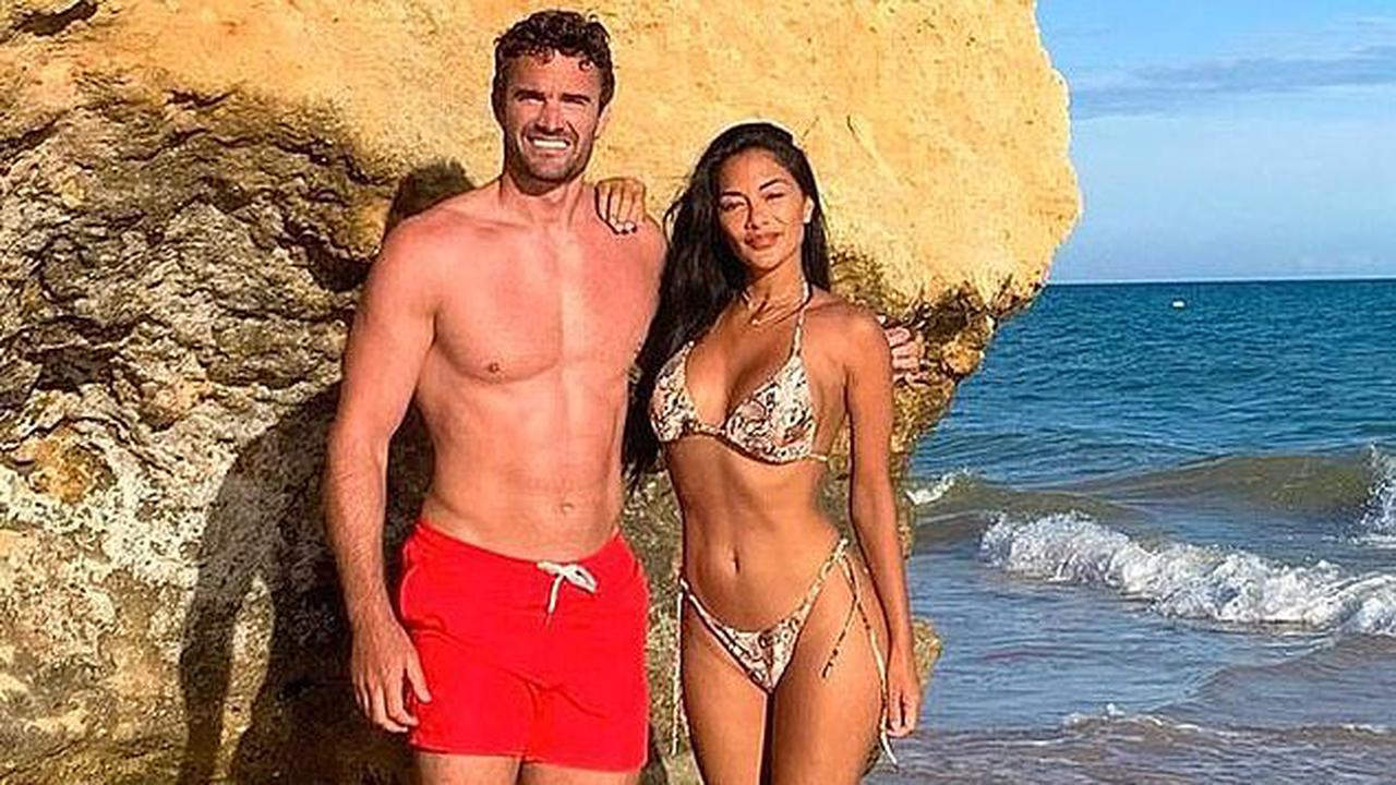Nicole Scherzinger shows off her incredible physique in a skimpy bikini in sizzling snaps with hunky beau Thom Evans