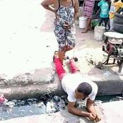 See How A Man Lied Down For His Wife Who Is About To Deliver A Baby In Order To Cross The Gutter