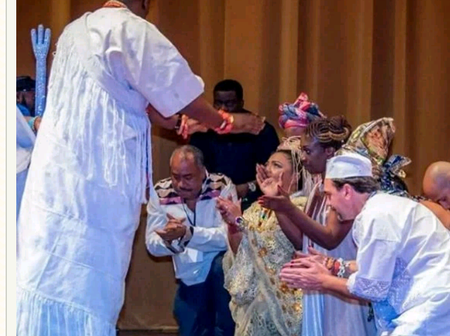 Photos Of Ooni Of Ife Praying And Talking With White People In Nigeria And Around The World