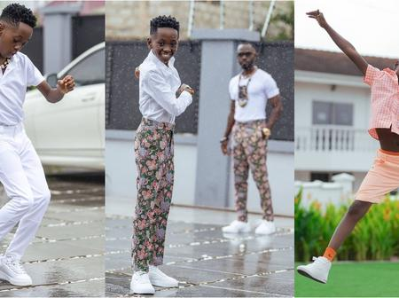 Okyeame Kwame and his son flaunt in new styles as they pose in the same Kente outfits