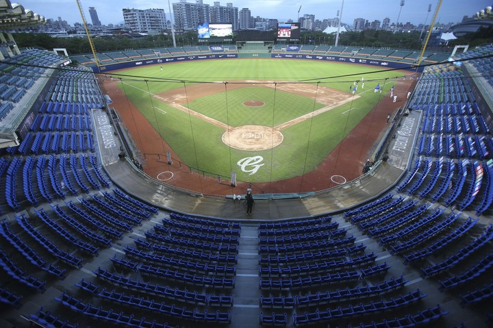 Slide 4 of 50: This Friday, April 24, 2020, photo shows the stands with no audience at Xinzhuang Baseball Stadium in New Taipei City, Taiwan. Taiwan's five-team Chinese Professional Baseball League is barring spectators over concerns of spreading the coronavirus in a crowded space. But Taiwan has relatively few cases of COVID-19, so the league decided it was safe to let in players, coaches, cheerleaders, costumed mascots, face mask-wearing batboys and the media. (AP Photo/Chiang Ying-ying)
