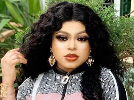 Bobrisky Stuns In An All-white Outfit and Headtie, Shows Off His Nice Makeup (Photos)