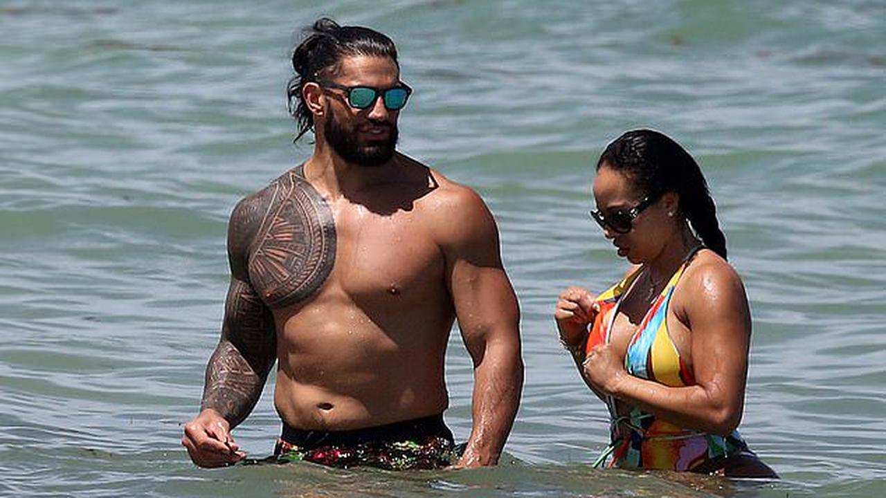 WWE star Roman Reigns shows off his buff physique while stunning wife Galina Becker sizzles in colourful swimsuit during Miami beach day