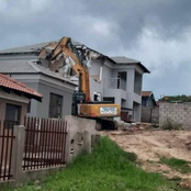 Well known business men demolishes a house he built for girlfriend after being dumped!