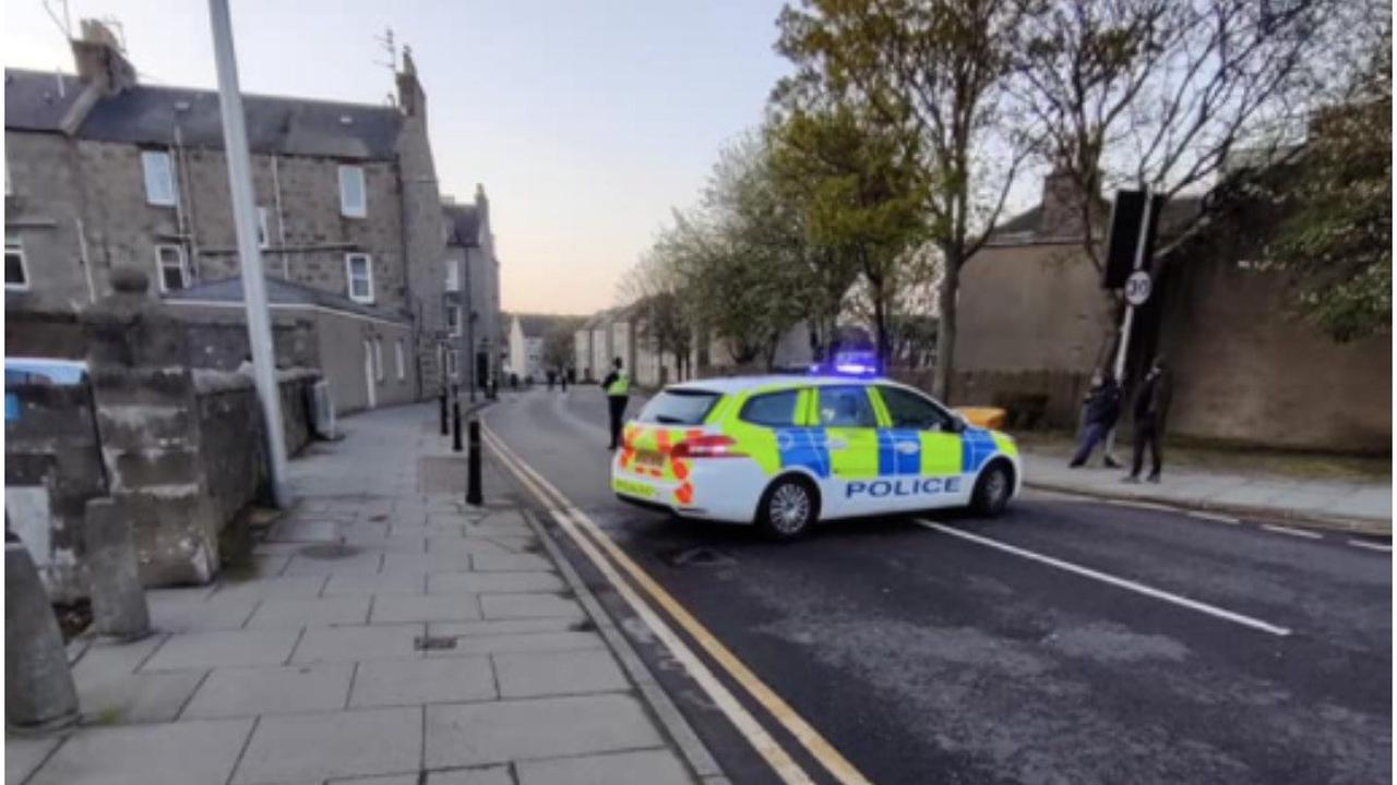 Armed cops lock down Scots street as they tackle 'disturbance'