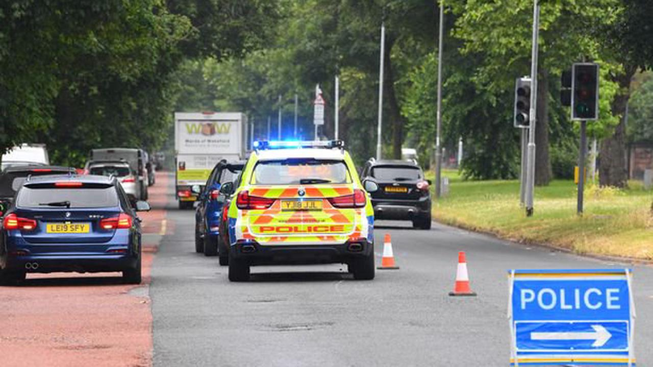 Electric bike rider suffers serious leg injury after crash with police car