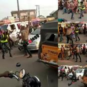 Video: A Man Allegedly Beats Up A Female Police Officer, Who Stopped Him For Questioning In Lagos.